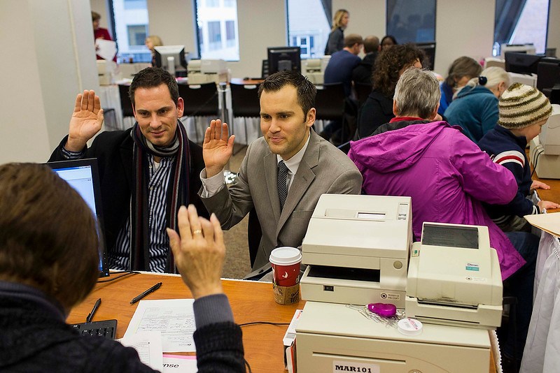 . David Mifflin, left, and Matt Beebe swear an oath while filing for their marriage license in Seattle, Washington December 6, 2012. Washington made history last month as one of three U.S. states where marriage rights were extended to same-sex couples by popular vote, joining Maryland and Maine in passing ballot initiatives recognizing gay nuptials.  REUTERS/Jordan Stead