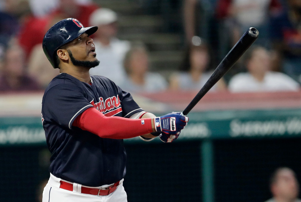 . Cleveland Indians\' Edwin Encarnacion watches his RBI sacrifice fly during the second inning of a baseball game against the Kansas City Royals, Tuesday, Sept. 4, 2018, in Cleveland. (AP Photo/Tony Dejak)