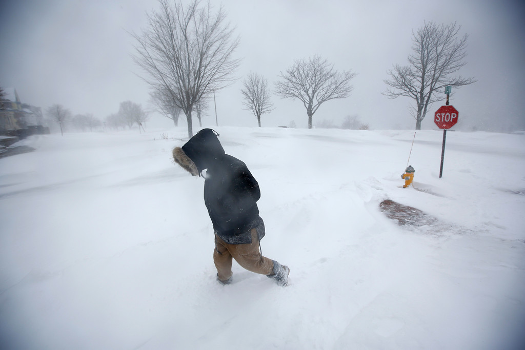 . Cassie Peterson trudges through wind-driven snow during the latest winter storm, Tuesday, March 13, 2018, in Portland, Maine. The third major nor\'easter in two weeks slammed the storm-battered Northeast Tuesday with blizzard conditions. (AP Photo/Robert F. Bukaty)