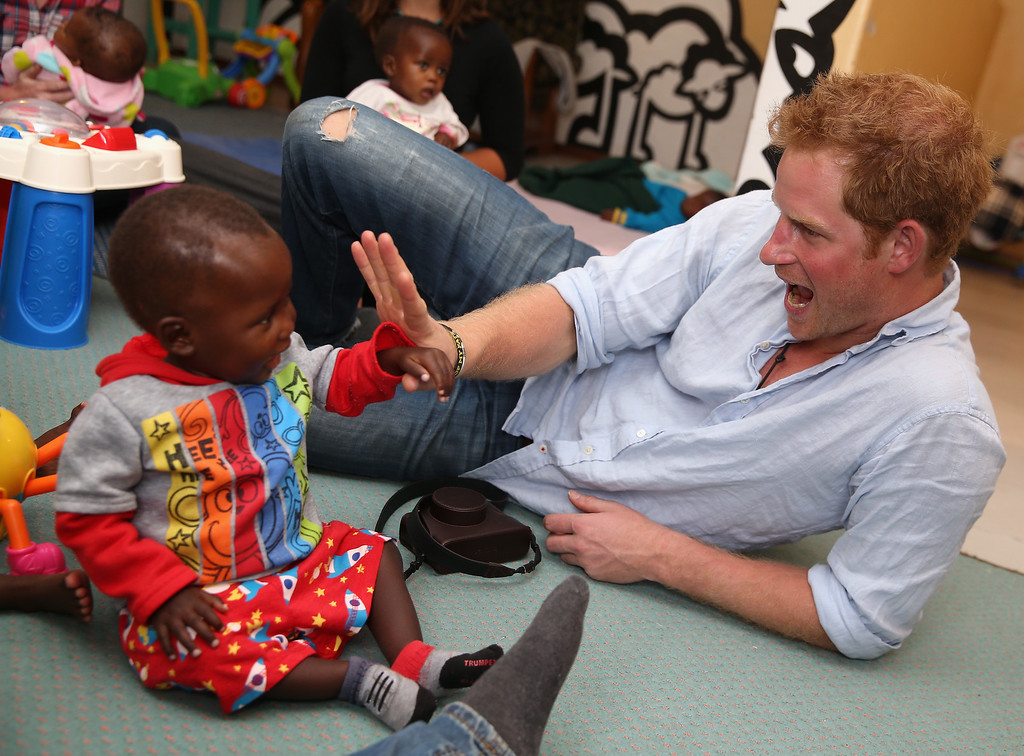 . Prince Harry plays with two young children (who are going through a programme for malnourishment) during a visit to the organisation supported by Sentebale \'Touching Tiny Lives\' on December 8, 2014 in Mokhotlong, Lesotho.  (Photo by Chris Jackson/Getty Images for Sentebale)