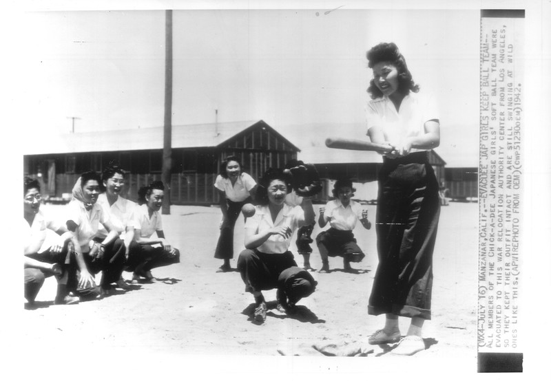 """""""Evacuee Jap Girls Keep Ball Team -- All members of the Chick-a-dee Japanese girls' soft ball team were evacuated to this war relocation authority center from Los Angeles"""" -- caption on photograph"""