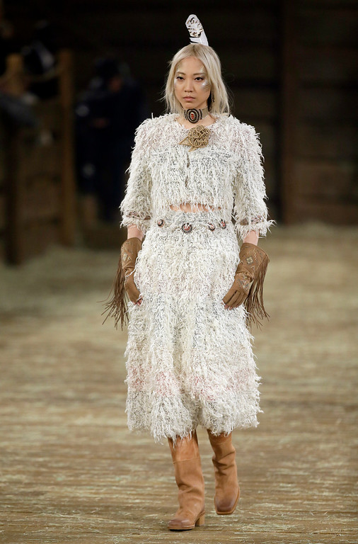 . A model walks the runway at Chanel\'s Metiers d\'Art fashion show, Tuesday, Dec. 10, 2013, in Dallas. (AP Photo/Tony Gutierrez)
