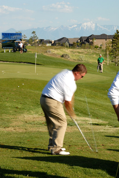 5/9/07 – Wednesdays are the Mstar Short Game Challenge. I slowed the shutter slow enough that you can see the ball rocketing off his club. It is the white streak.