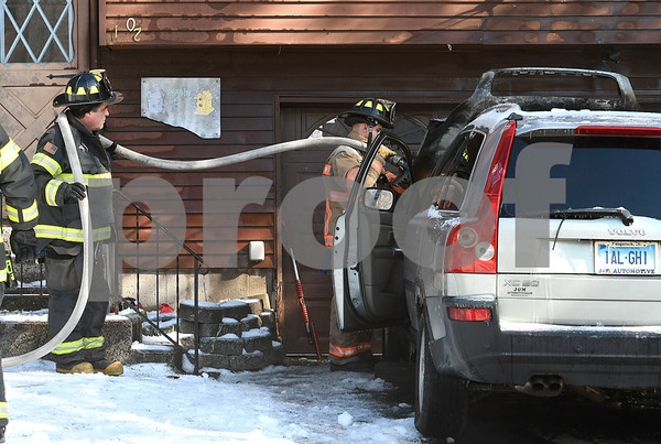 2/8/2018 Mike Orazzi   Staff Bristol firefighters extinguish a vehicle fire next to a home at 102 Indiana Street in Bristol Thursday afternoon.