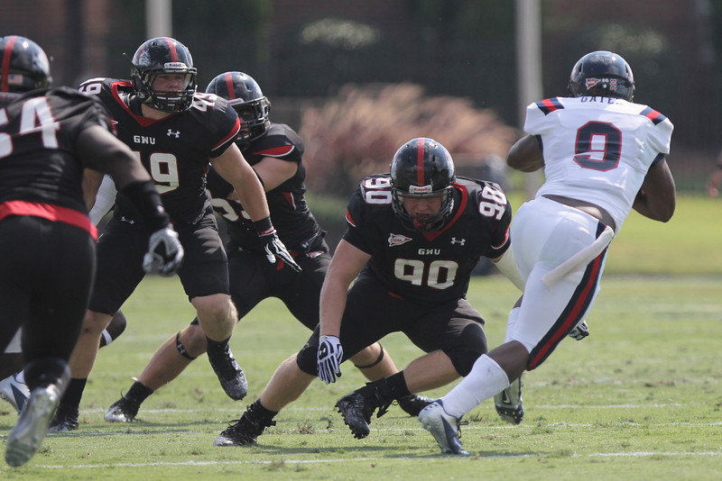Dylan Taylor (90) attempts to tackle Samford's player