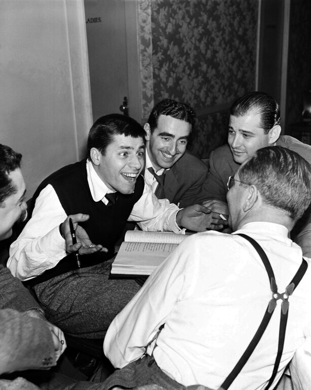 ". Television writers join Jerry Lewis as they rehearse for the television show, ""The Dean Martin - Jerry Lewis show for  NBC on  May 15, 1951in New York.   Photo shows (l to r) Kingman T. Moore, TV director, Jerry Lewis, Ed Simmons, writer Norman Lear, and Ernie Glucksman, producer.  (AP Photo/ Robert Kradin)"