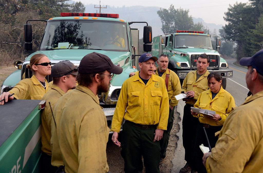. U.S. Forest Service strike teams from Santa Barbara, Stanislaus and Sonora Counties gather near the Pfeiffer Ridge Road entrance before heading in to battle the fire in the area in Big Sur, Calif. on Monday December 16, 2013. (Photo David Royal/ Monterey County Herald)