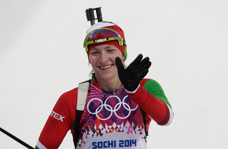 . Belarus\' Darya Domracheva celebrates winning the gold during the women\'s 15K individual biathlon race at the 2014 Winter Olympics, Friday, Feb. 14, 2014, in Krasnaya Polyana, Russia. (AP Photo/Matthias Schrader)