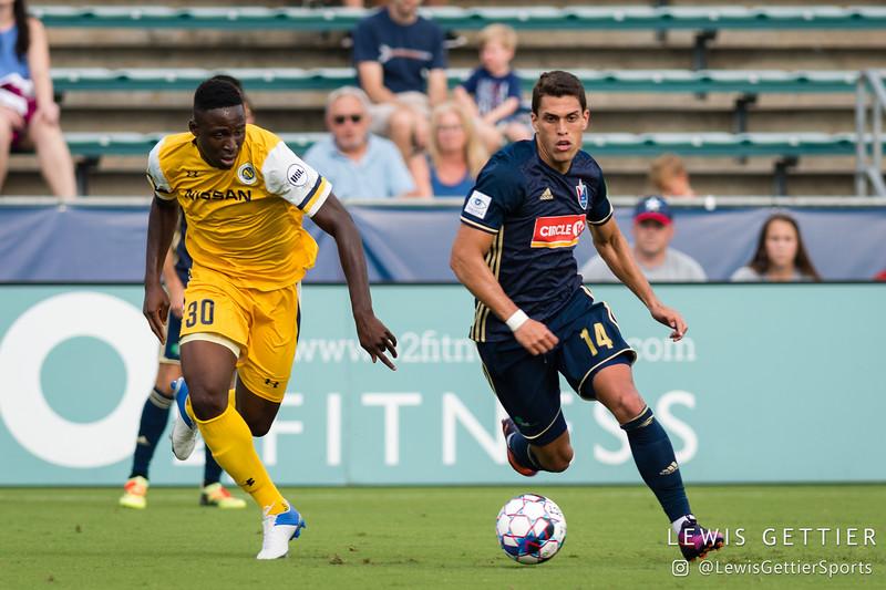 Nashville SC midfielder Bolu Akinyode (30) and North Carolina FC forward Daniel Rios (14)