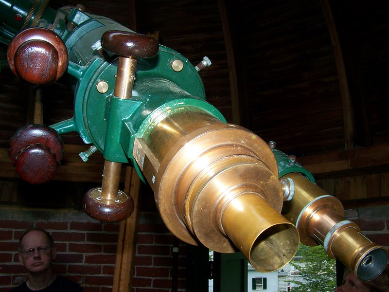 6 inch refractor has beautifulmetalwork at the tail stock of the instrument. Note the wooden knobs.