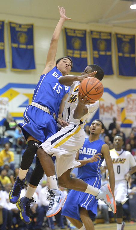 . LONG BEACH, CALIF. USA -- Millikan\'s Mark Thomas (11) tries to take a shot around Gahr\'s Anthony Austin (15) during their CIF-SS Divison 1-A playoff game in Long Beach on February 15, 2013. Millikan defeated Gahr, 74 to 64. Photo by Jeff Gritchen / Los Angeles Newspaper Group