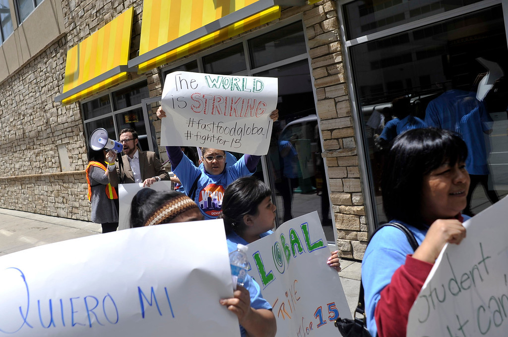 . DENVER, COLORADO - MAY 15: Denver fast food workers and supporters exit the McDonald\'s at 16th St. and Cleveland Pl. in Denver. Fast food workers across the nation rallied for better pay and the right to form unions on Thursday, May 15, 2014. (Photo by Patrick Traylor/The Denver Post)