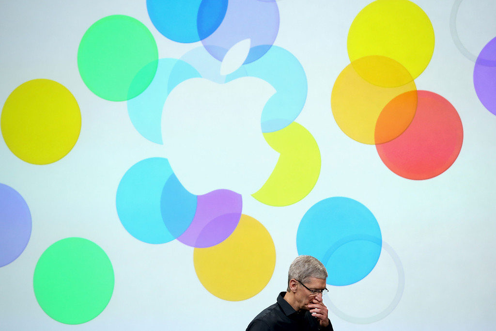 . Apple CEO Tim Cook speaks on stage during an Apple product announcement at the Apple campus on September 10, 2013 in Cupertino, California. The company is expected to launch at least one new iPhone model.  (Photo by Justin Sullivan/Getty Images)