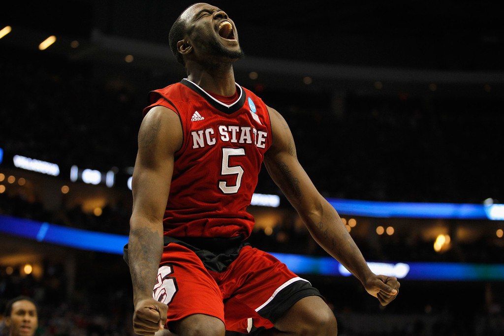 . Desmond Lee #5 of the North Carolina State Wolfpack celebrates after the Wolfpack defeated the Villanova Wildcats 71-68 during the third round of the 2015 NCAA Men\'s Basketball Tournament at Consol Energy Center on March 21, 2015 in Pittsburgh, Pennsylvania.  (Photo by Justin K. Aller/Getty Images)