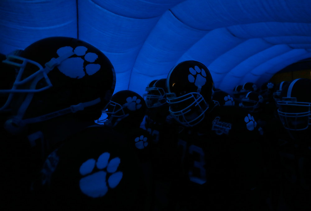 Description of . The Clemson Tigers prepare to enter the field to face the LSU Tigers during the 2012 Chick-fil-A Bowl at Georgia Dome on December 31, 2012 in Atlanta, Georgia.  (Photo by Kevin C. Cox/Getty Images)