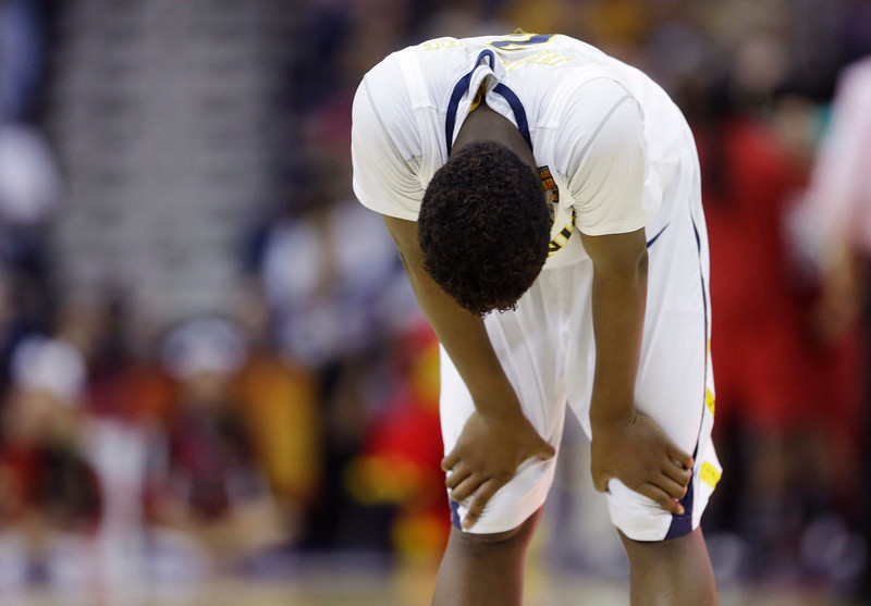 . California guard Afure Jemerigbe (2) looks down in the second half of a national semifinal at the Women\'s Final Four of the NCAA college basketball tournament, Sunday, April 7, 2013, in New Orleans. Louisville won 64-57. (AP Photo/Gerald Herbert)
