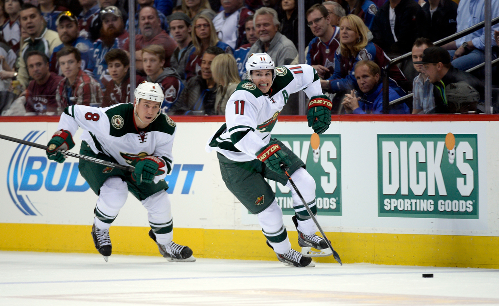 . Zach Parise (11) of the Minnesota Wild takes the puck down ice during the second period of action. The Colorado Avalanche hosted the Minnesota Wild for the first playoff game at the Pepsi Center on Thursday, April 17, 2014. (Photo by John Leyba/The Denver Post)