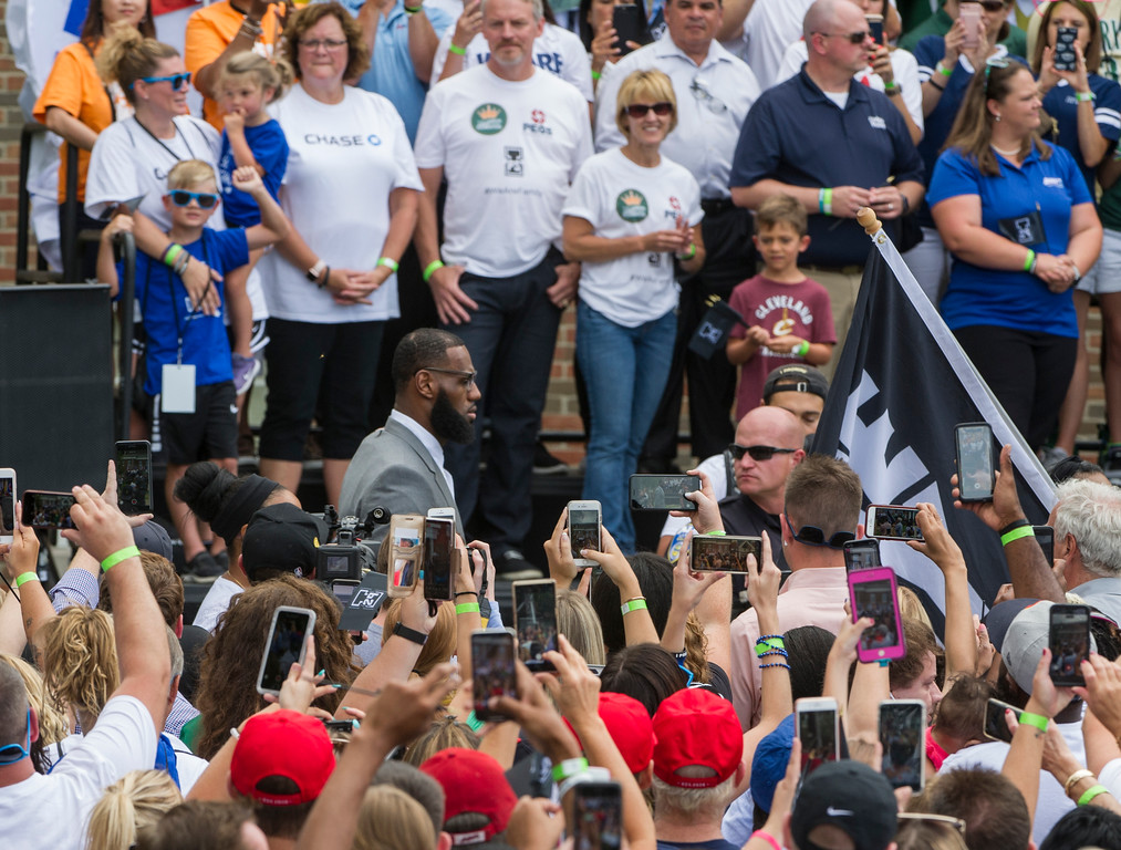 . LeBron James walks past the crowd before speaking at the opening ceremony for the I Promise School in Akron, Ohio, Monday, July 30, 2018. The I Promise School is supported by the The LeBron James Family Foundation and is run by the Akron Public Schools. (AP Photo/Phil Long)