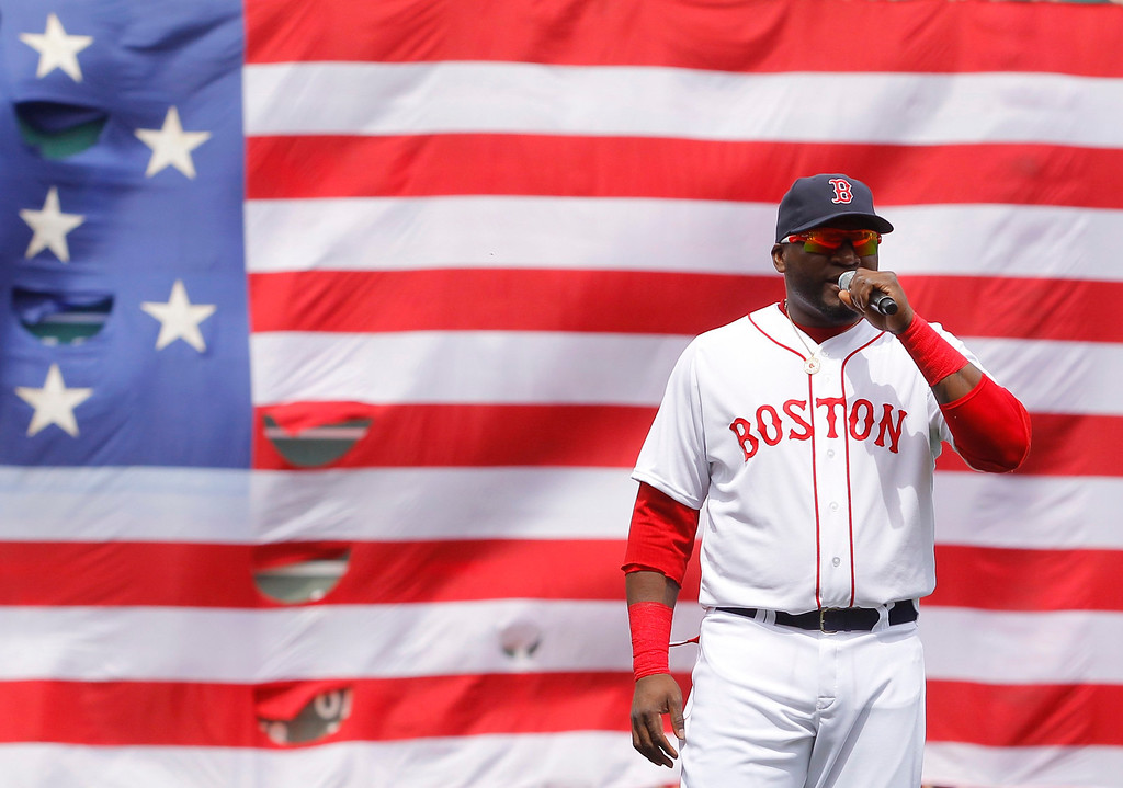 . Boston Red Sox\'s David Ortiz addresses fans during a pre-game ceremony honoring the victims of the Boston Marathon bombings, before the team\'s MLB American League baseball game against the Kansas City Royals at Fenway Park in Boston, Massachusetts April 20, 2013. REUTERS/Jessica Rinaldi