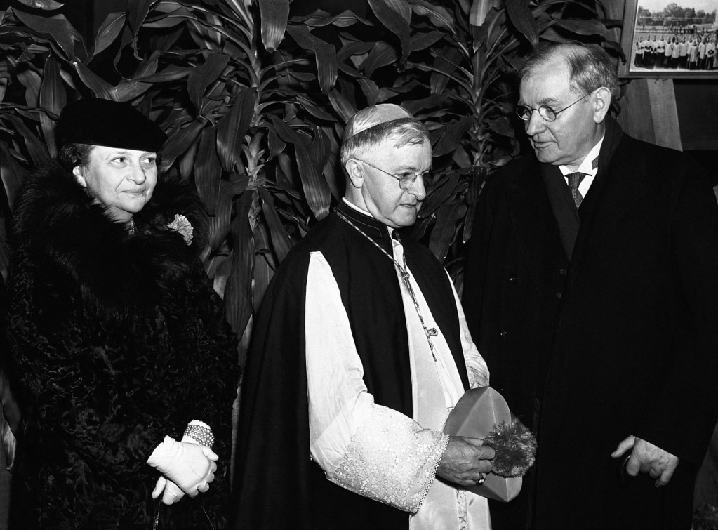 . The custom of �The Red Mass�, inaugurated in France centuries ago by judges and legislators to invoke the air of divine wisdom and justice for their deliberations in the sessions to follow, was introduced in the capital, Jan. 9, 1939 at the national shrine of the immaculate conception at Catholic University. Shown with the most Rev. John T. McNicholas, center, archbishop of Cincinnati, who delivered the sermon, are justice Pierce Butler, right, of the Supreme Court, and labor secretary Frances Perkins. (AP Photo)