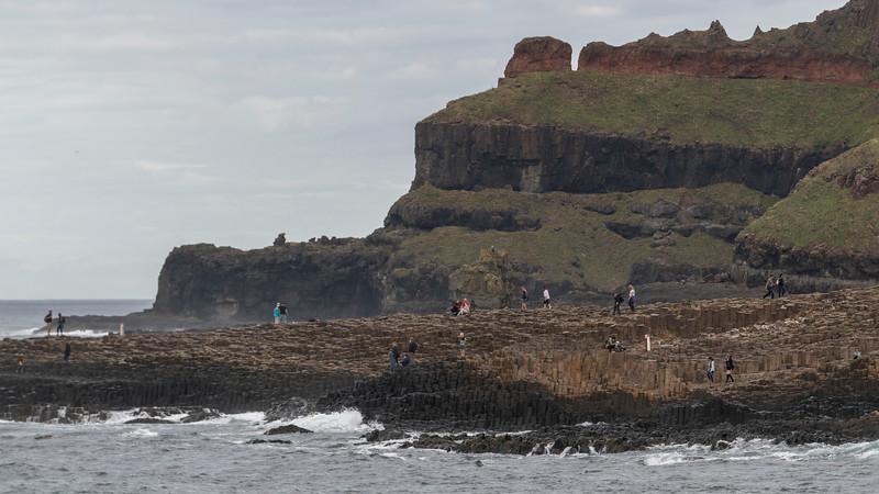 Tourists on the coast, Giant's Causeway, County Antrim, Northern Ireland, Ireland