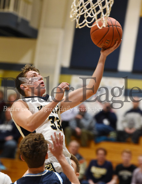 Harold Aughton/Butler Eagle: Knoch's Jake Schiedt, #33, powers to the basket against during Saturday's game against Burrell, January 18, 2020.
