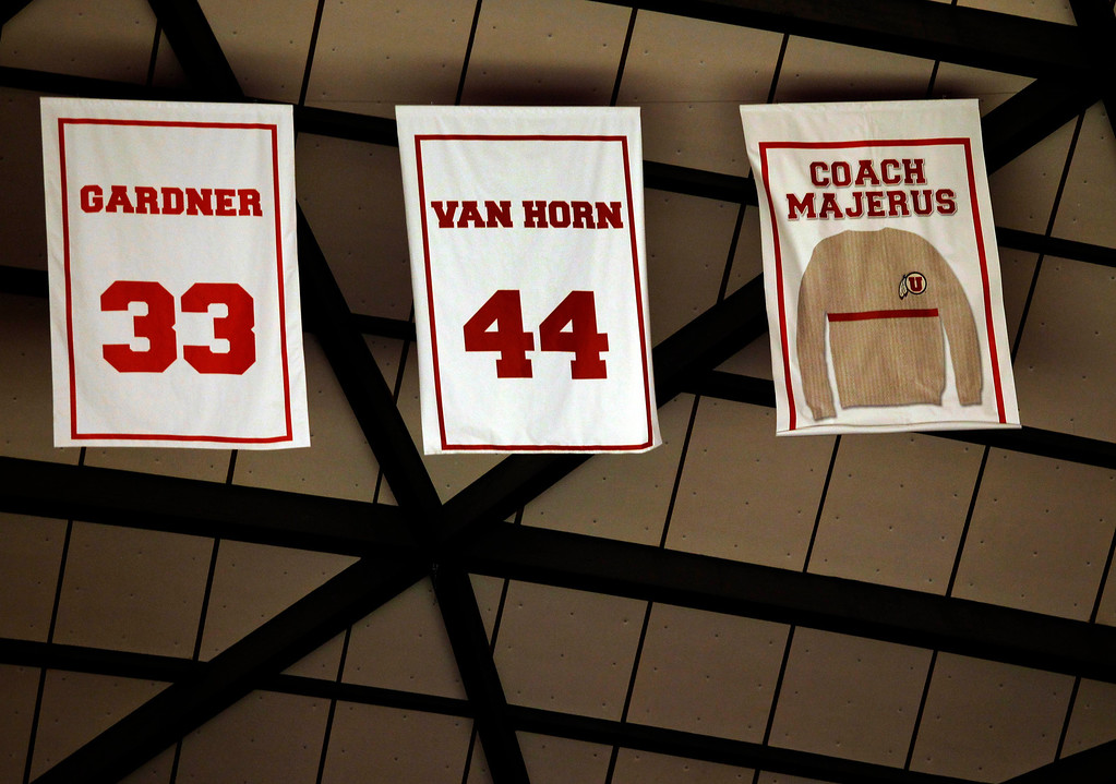 . Former Utah head coach Rick Majerus\' sweater is retired to the rafters of the Jon M. Hunstman Center during halftime of an NCAA college basketball game against Colorado on Saturday, Feb. 2, 2013 in Salt Lake City. Majerus coached at Utah for 14 years. (AP Photo/Steve C. Wilson)