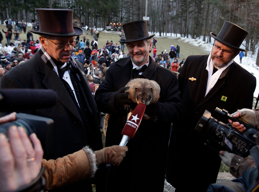 . John Griffiths, center, holds the weather-predicting groundhog Punxsutawney Phil as Phil is interviewed by media at Gobbler\'s Knob on Groundhog Day, Monday, Feb. 2, 2009, in Punxsutawney, Pa. The Groundhog Club said Phil saw his shadow and predicted six more weeks of winter. To the left is Bill Cooper and at right is Ben Hughes. (AP Photo/Carolyn Kaster)