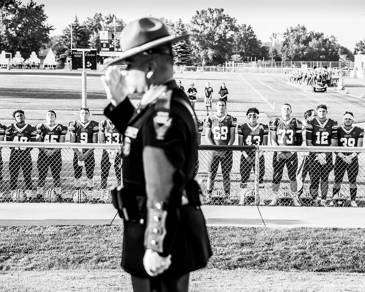 Son of fallen officer Kenny Velez Christian Velez and his teamates take a moment as they raise the flag in honor of his father-2.jpg