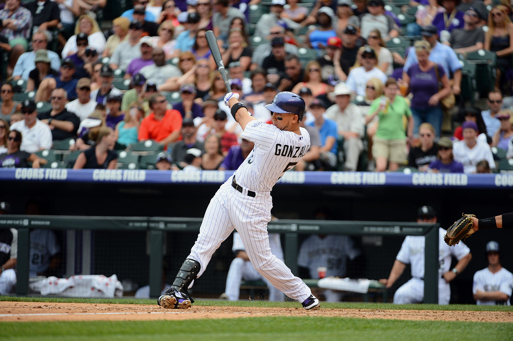 . Carlos Gonzalez #5 of the Colorado Rockies hits a home run during the game against the San Francisco Giants at Coors Field on June 30, 2013 in Denver, Colorado.  (Photo by Garrett W. Ellwood/Getty Images)