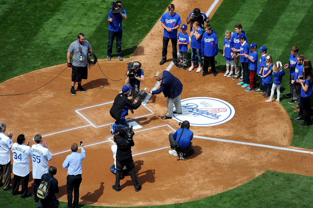 . Dodger announcer Vin Scully hands the ball to Sandy Koufax for the first pitch at the Dodgers home opener, Friday, April 4, 2014, at Dodger Stadium. (Photo by Michael Owen Baker/L.A. Daily News)