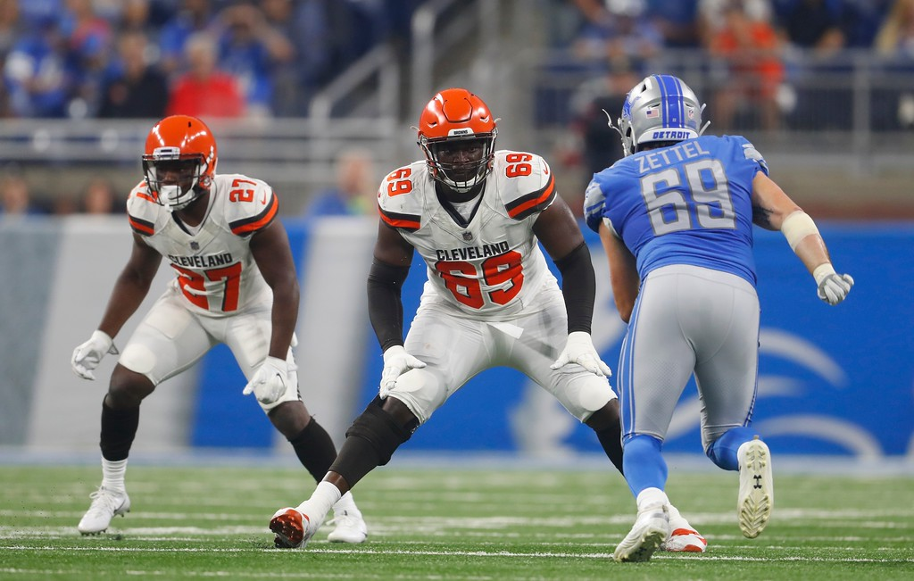 . Cleveland Browns offensive tackle Desmond Harrison (69) defends the line as Detroit Lions defensive end Anthony Zettel (69) rushes during the first half of an NFL football preseason game, Thursday, Aug. 30, 2018, in Detroit. (AP Photo/Paul Sancya)