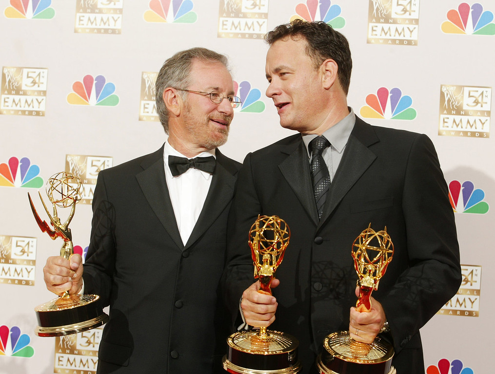 . Band Of Brothers Executive Producers Steven Spielberg (left) and Tom Hanks celebrate their Emmy for Outstanding Miniseries in the press room at the 54th Annual Primetime Emmy Awards at the Shrine Auditorium in Los Angeles, CA on Sunday, September 22, 2002. Photo credit: Kevin Winter/ImageDirect