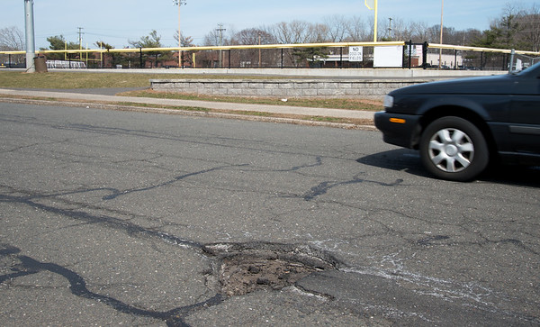03/28/19 Wesley Bunnell | Staff Potholes line Wildwood St in front of the police substation on Thursday afternoon. The problem was reported by a resident using the See Click Fix app on March 15th with it being marked by the city as assigned to a streets foreperson and subsequently a streets foreperson acknowledging the request on March 19th.