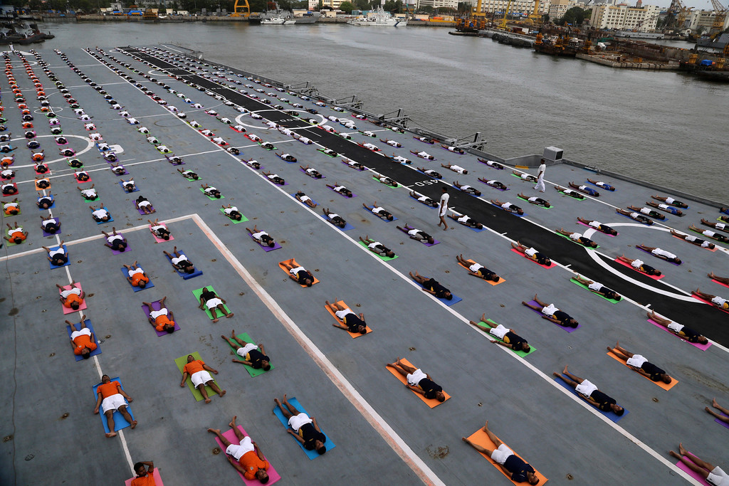 . Indian armed forces and their families members perform Yoga on the deck of the Indian Naval aircraft carrier Viraat to mark International Yoga Day in Mumbai, India, Wednesday, June 21, 2017. Yoga practitioners took a relaxing break to bend, twist and pose Wednesday morning for the annual event celebrating the practice, especially in the country where it began. (AP Photo/Rajanish Kakade)