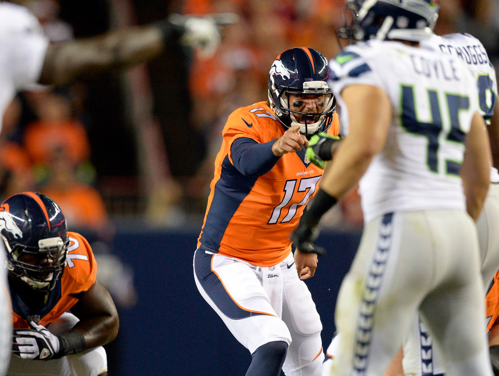 . Quarterback Brock Osweiler (17) of the Denver Broncos calls a play during the second quarter.  The Denver Broncos vs the Seattle Seahawks At Sports Authority Field at Mile High. (Photo by John Leyba/The Denver Post)