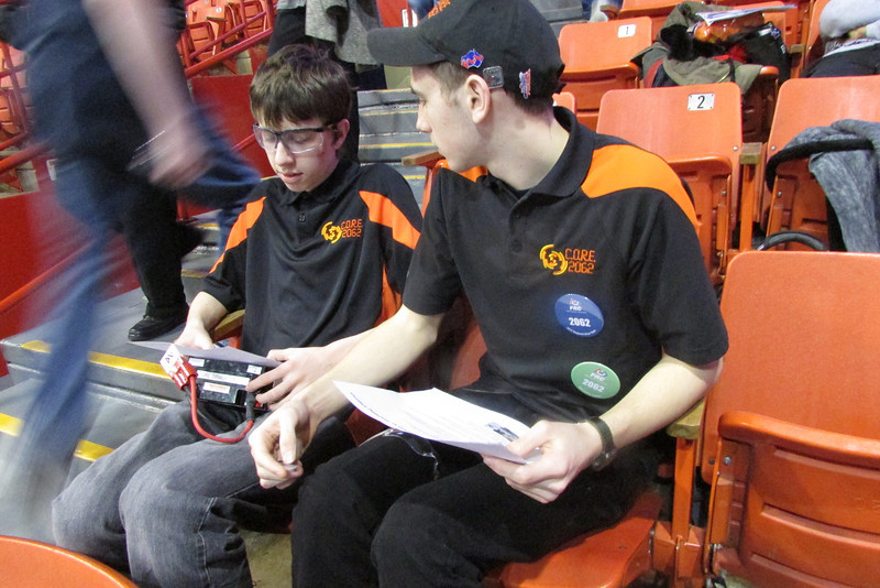 In between our matches, Curtis and others give safety demos to other teams. Curtis is helping go over battery safety with David so he can give demos while Curtis is on the field.