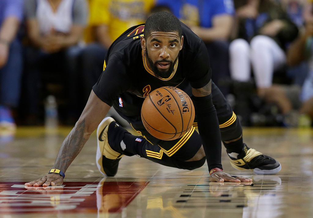 . Cleveland Cavaliers guard Kyrie Irving (2) looks at a loose ball during the second half of Game 7 of basketball\'s NBA Finals against the Golden State Warriors in Oakland, Calif., Sunday, June 19, 2016. (AP Photo/Marcio Jose Sanchez)