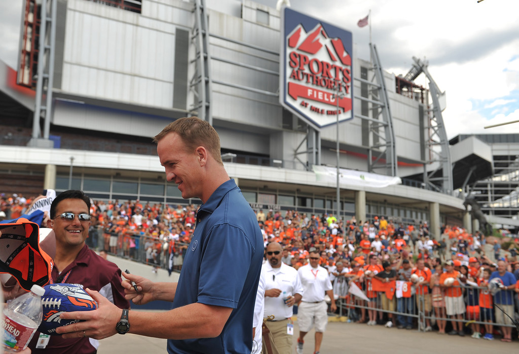 . DENVER, CO. - August 03: Denver Broncos quarterback Peyton Manning signs autographs for fans at Sports Authority Field at Mile High. Denver, Colorado. August 03, 2013. (Photo By Hyoung Chang/The Denver Post)