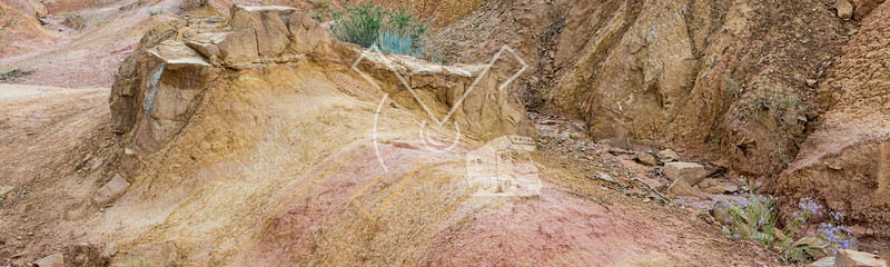 """Detail of eroded mud in badland valley in the red sandstone landscape at the """"Fairy tale canyon"""""""
