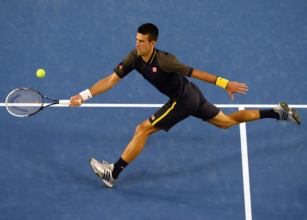. Serbia\'s Novak Djokovic hits a return against Britain\'s Andy Murray during the men\'s singles final on day 14 of the Australian Open tennis tournament in Melbourne on January 27, 2013.  WILLIAM WEST/AFP/Getty Images