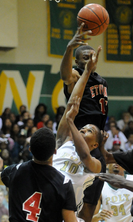 . 02-26-2012--(LANG Staff Photo by Sean Hiller)-Etiwanda beat Long Beach Poly 59-55 in Tuesday\'s CIF Southern Section Division 1AA semifinal boys basketball game at Long Beach Poly High School. Ke\'jhan Feagin finds himself surrounded by Etiwanda defense.