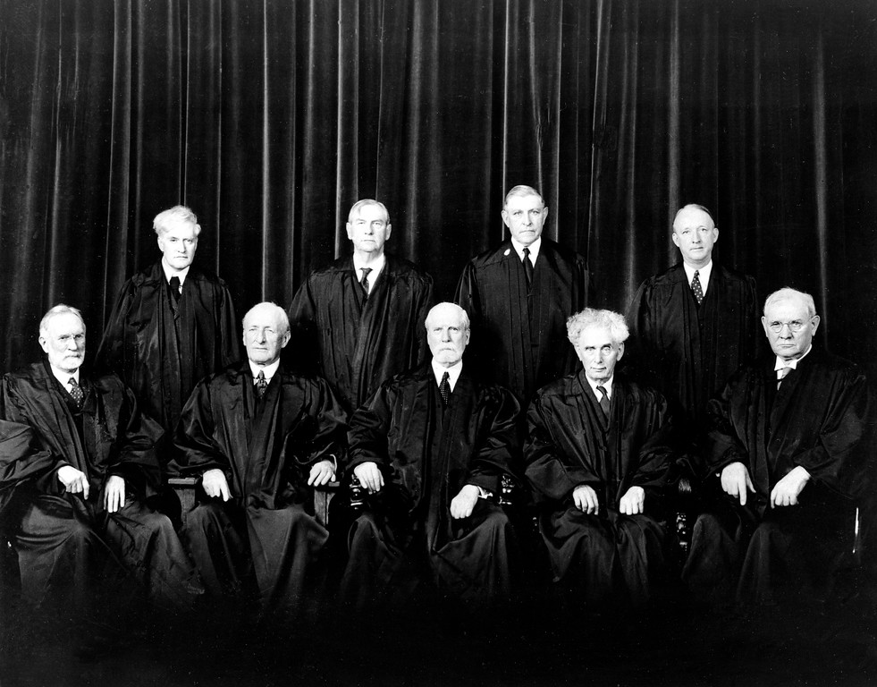 . FILE - In this Nov. 18, 1937, file photo, nembers of the United States Supreme Court pose in their robes in Washington.  Seated, from left, are, Justice George Sutherland; James Clark McReynolds; Charles Evans Hughes; Louis Dembitz Brandeis; and Pierce Butler.  Standing, from left, are, Benjamin Nathan Cardozo; Harlan Fiske Stone; Owen Josephus Roberts; and Hugo Lafayette Black, the newest member. No one endured a longer time between nomination and confirmation as a Supreme Court justice than Brandeis, the famed lawyer, political reformer and first Jewish justice. That could change soon if Republicans maintain their resolve not to confirm or even consider anyone President Barack Obama nominates to the Supreme Court to take the place of Justice Antonin Scalia, who died in February 2016. (AP Photo)
