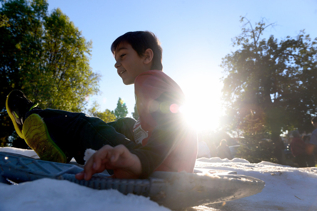 . Children go sledding during Montebello\'s annual Winter Wonderland at Montebello City Park Saturday, December 14, 2013. (Photo by Sarah Reingewirtz/Pasadena Star-News)