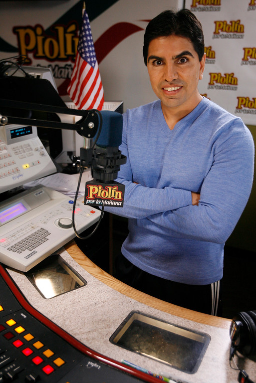 ". Mexican-American radio personality Eddie ""Piolín\"" Sotelo records his show \""Piolín por la Manana\"" at a radio studio in Glendale, Calif. on Friday, Oct. 17, 2008. Piolin\'s show is one of the highest-rated Spanish-language radio programs in the country. (AP Photo/Damian Dovarganes)"