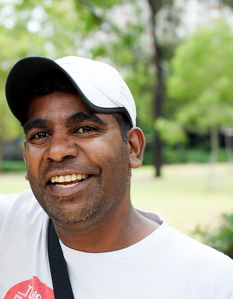 Aboriginal Man in his 30s, smiling broadly