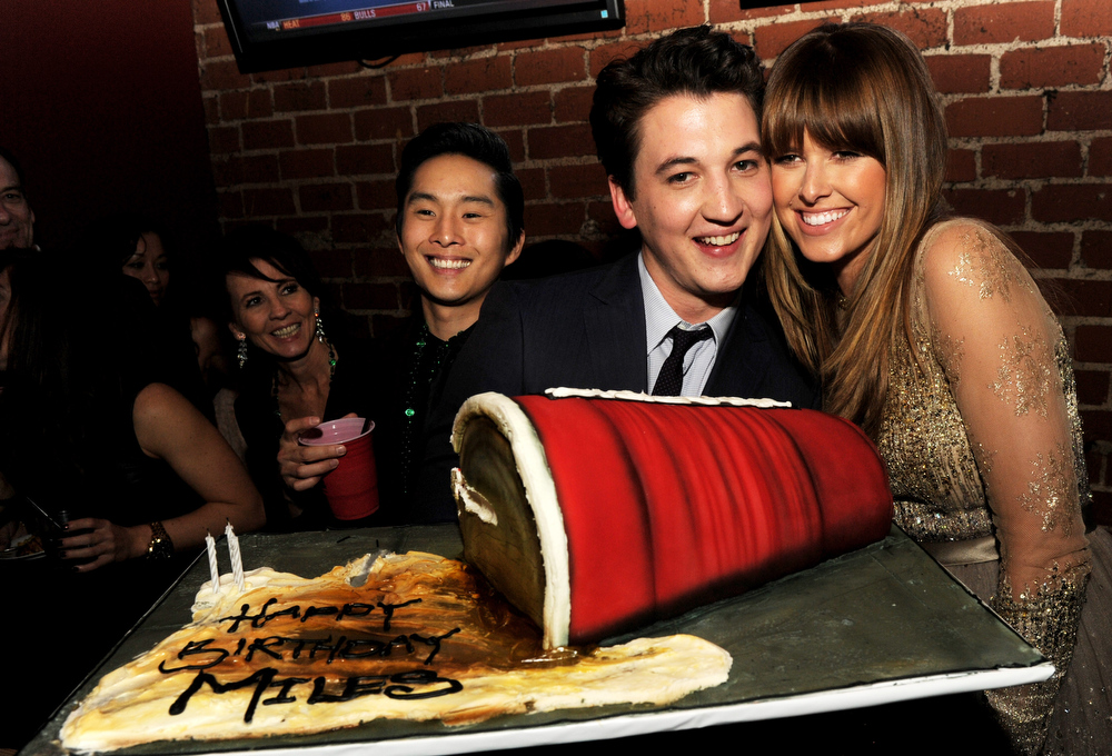 ". Actors Justin Chon, Miles Teller and Sarah Wright pose at the after party for the premiere of Relativity Media\'s ""21 And Over\"" at the Westwood Brewery on February 21, 2013 in Los Angeles, California.  (Photo by Kevin Winter/Getty Images)"