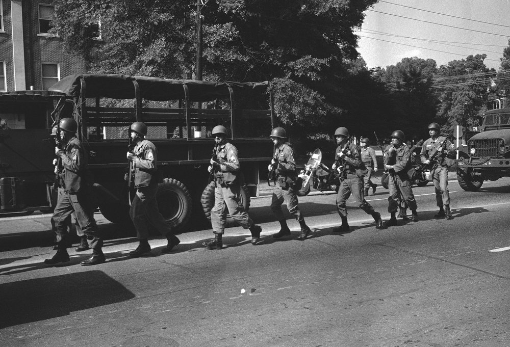 . Troops from the federalized National Guard arrive on the campus of the University of Alabama, June 11, 1963 in Tuscaloosa. President Kennedy ordered the guard into service after Gov. George Wallace turned back two black students attempting to integrate the institution. (AP Photo)