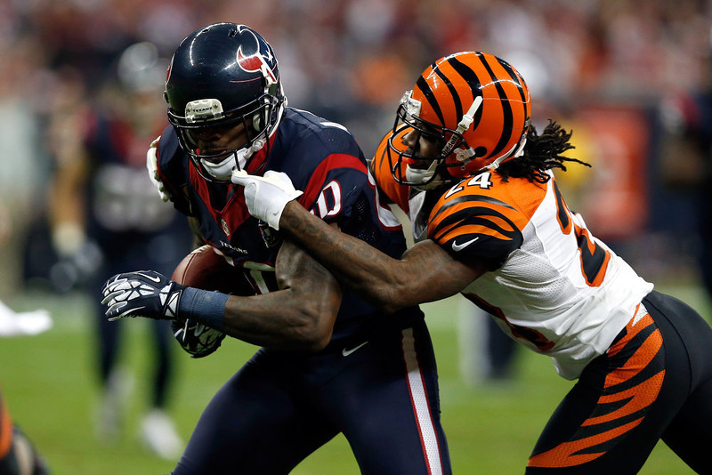 . Andre Johnson #80 of the Houston Texans makes a reception against Adam Jones #24 of the Cincinnati Bengals during their AFC Wild Card Playoff Game at Reliant Stadium on January 5, 2013 in Houston, Texas.  (Photo by Scott Halleran/Getty Images)