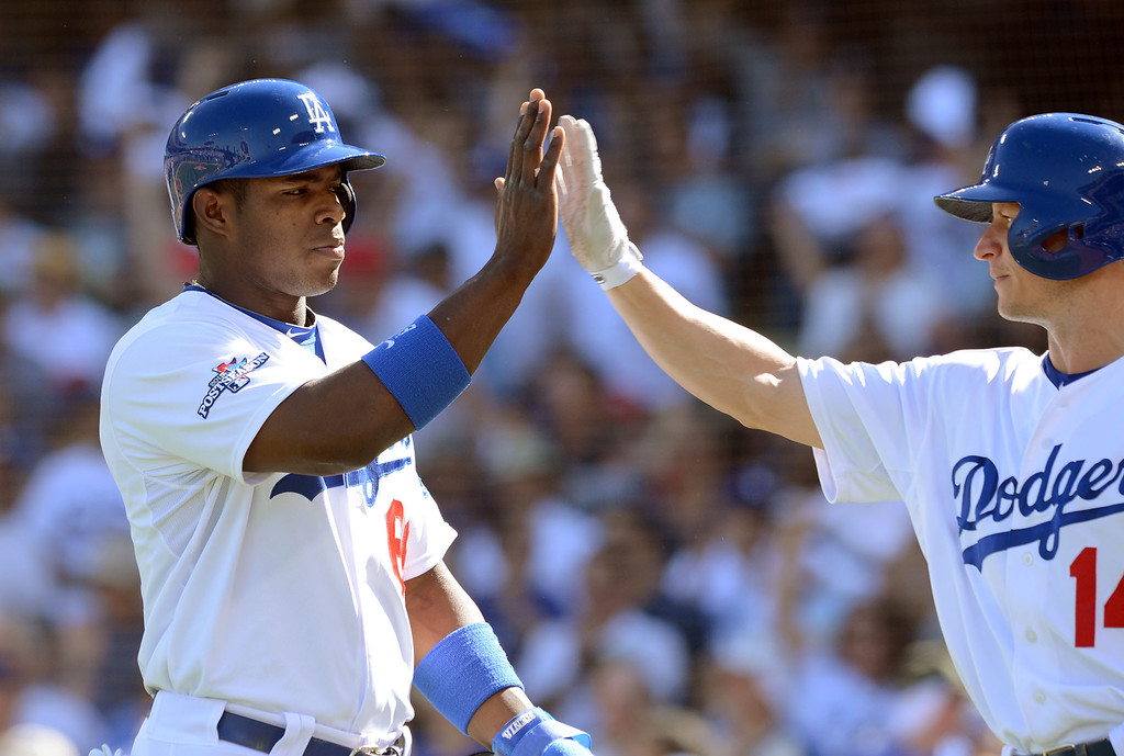 . The Dodgers\' Yasiel Puig is congratulated by Mark Ellis after scoring in the 2nd inning against the Cardinals in the game 5 of the NLCS at Dodger Stadium Wednesday, October 16, 2013.(David Crane/Los Angeles Daily News)
